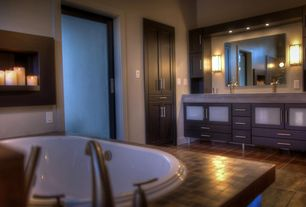 Contemporary Master Bathroom with French doors, Built-in bookshelf, Limestone counters, Wall sconce, slate tile floors, Flush