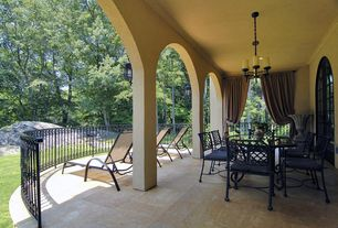 Mediterranean Patio with French doors, Deck Railing, exterior stone floors