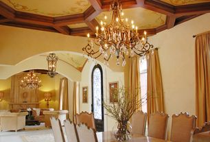 Mediterranean Great Room with Chandelier, Cement fireplace, Glass panel door, Casement, Crown molding, can lights, Fireplace
