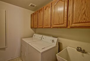 Craftsman Laundry Room with Farmhouse sink, Built-in bookshelf, limestone floors