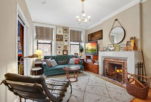Eclectic Living Room with Chandelier, Hardwood floors, Crown molding, Christies, specialty door