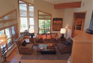 Living Room with High ceiling, Window seat, Area rug, Hardwood floors