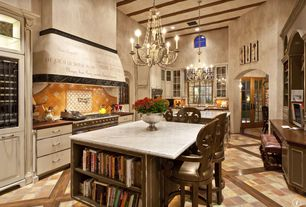 Mediterranean Kitchen with Glass panel, Wood plank with tile flooring, High ceiling, Wine refrigerator, can lights, wall oven