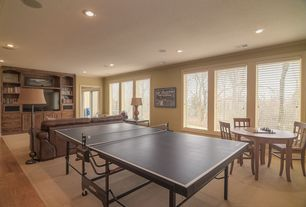 Traditional Game Room with Crown molding, Casement, Standard height, can lights, Hardwood floors