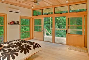 Contemporary room with Ceiling fan, sliding glass door, Hardwood floors, Standard height, flush light, picture window