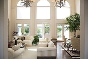 Traditional Living Room with Hardwood floors, Area rug, Chandelier, Quorum Fulton 6 Light Chandelier with Cream Shade