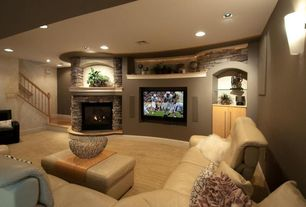 Contemporary Living Room with Wall sconce, Carpet, Built-in bookshelf, Sunken living room, stone fireplace