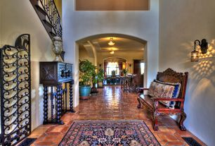 Mediterranean Hallway with flush light, High ceiling, specialty window, Built-in bookshelf, Wall sconce, Interlocking Pavers