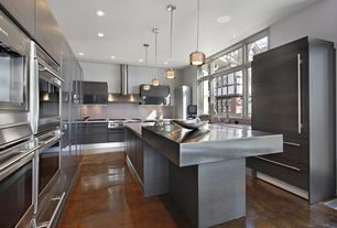 Contemporary Kitchen with Limestone counters, Bellmont Cabinets - Terra TSS Carbon, Stone Tile, Stained concrete floor, Flush
