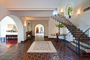 Eclectic Staircase with terracotta tile floors, Arched window, High ceiling, Wall sconce