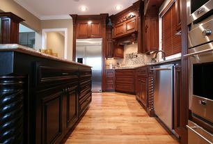 Traditional Kitchen with Simple granite counters, Custom hood, Columns, Raised panel, L-shaped, Stone Tile, Kitchen island