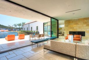 Contemporary Living Room with picture window, limestone tile floors, stone tile floors, sliding glass door, can lights