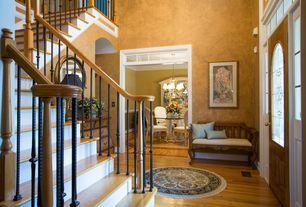 Traditional Entryway with Glass panel door, Built-in bookshelf, specialty window, High ceiling, Hardwood floors