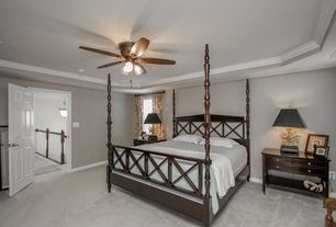 Traditional Master Bedroom with Ceiling fan, Carpet, Crown molding
