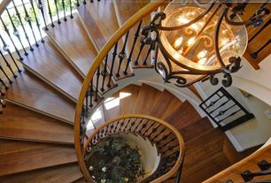 Mediterranean Staircase with Spiral staircase, Hardwood floors, Chandelier, Cathedral ceiling