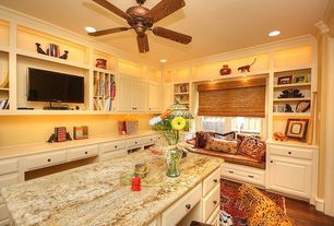 Traditional Home Office with Ceiling fan, Window seat, Hardwood floors, can lights, Built-in bookshelf, Crown molding