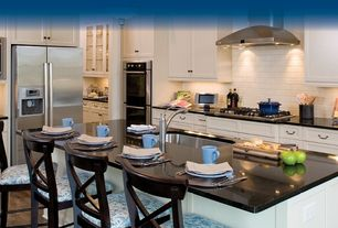 Traditional Kitchen with L-shaped, can lights, built-in microwave, double wall oven, Wall Hood, Flat panel cabinets, Flush