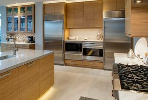Contemporary Kitchen with wall oven, Built In Refrigerator, Undermount sink, Flush, Formica counters, Wolfe gas cooktop