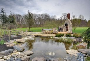 Rustic Landscape/Yard with exterior stone floors, Pond