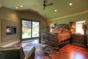 Eclectic Master Bedroom with Hardwood floors, can lights, Paint, Armstrong handscraped cherry engineered flooring, Fireplace