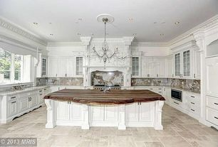 Traditional Kitchen with Glass panel, Custom hood, Undermount sink, Standard height, Chandelier, electric cooktop, Casement