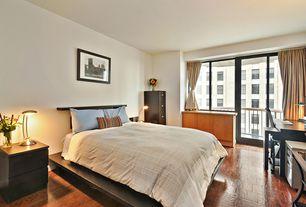 Modern Guest Bedroom with picture window, Standard height, sliding glass door, Hardwood floors, Built-in bookshelf