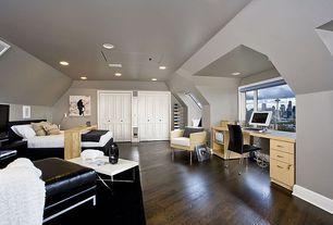 Modern Guest Bedroom with Built-in bookshelf, six panel door, Hardwood floors, picture window, Paint, can lights