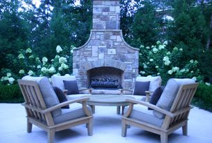 Traditional Patio with Outdoor fireplace, International home miami amazonia teak dining arm chair, exterior stone floors