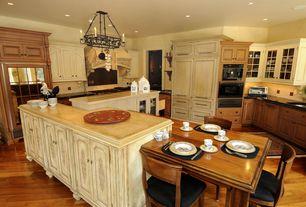 Traditional Kitchen with Undermount sink, Chandelier, Glass panel, Breakfast nook, Raised panel, Kitchen island, U-shaped