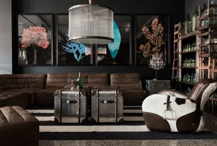 Eclectic Living Room with Carpet, Timothy Oulton Shabby Sofa, flush light, Butler Metalworks Midway Aviator End Table