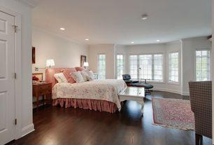 Country Master Bedroom with Crown molding, Hardwood floors, Bay window