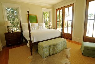 Traditional Master Bedroom with Napa natural herringbone handmade jute rug, Hardwood floors, Crown molding, French doors