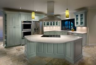 Modern Kitchen with slate tile floors, Corian counters, Glass panel, Crown molding, Breakfast bar, L-shaped, Pendant light