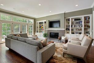 Traditional Living Room with Crown molding, Bamboo floors, Built-in bookshelf, French doors, Custom built-in shelving