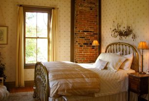 Traditional Guest Bedroom with double-hung window, Crown molding, Hardwood floors, interior wallpaper, interior brick