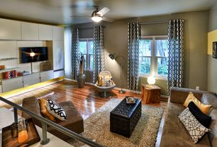 Contemporary Living Room with Ceiling fan, Hardwood floors, Standard height, double-hung window, Built-in bookshelf
