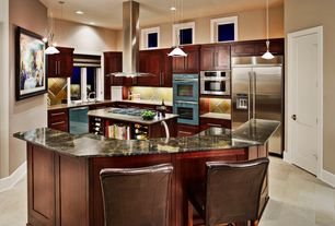 Contemporary Kitchen with Stone Tile, can lights, Island Hood, Built In Refrigerator, Standard height, Breakfast bar, Flush