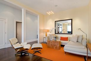 Contemporary Living Room with Hardwood floors, Columns, Pendant light