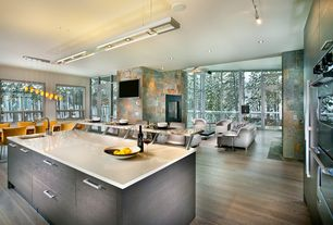 Contemporary Great Room with Oak - Spice 3 1/4 in. Solid Hardwood Plank, Hardwood floors, High ceiling, Pendant light