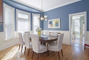 Traditional Dining Room with Standard height, double-hung window, Paint, Bay window, Chandelier, Hardwood floors