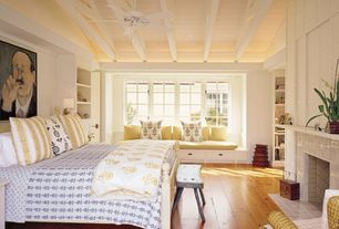 Cottage Master Bedroom with Built-in bookshelf, High ceiling, Tiles fireplace, Hardwood floors, Ceiling fan, Window seat