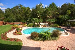 Mediterranean Swimming Pool with Pool with hot tub, Raised beds, Pathway, exterior stone floors, Fence