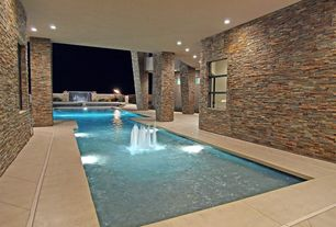 Contemporary Swimming Pool with exterior concrete tile floors, double-hung window, Indoor pool, exterior tile floors