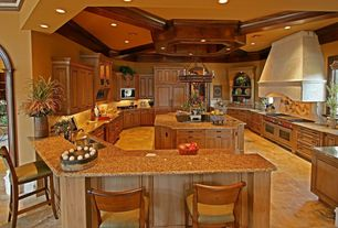 Traditional Kitchen with Raised panel, Double oven gas range, limestone tile floors, Crown molding, Stone Tile, Chandelier