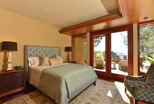 Craftsman Guest Bedroom with Hardwood floors, French doors
