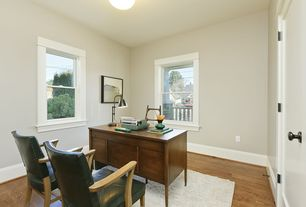 Traditional Home Office with Hardwood floors, flush light, specialty door