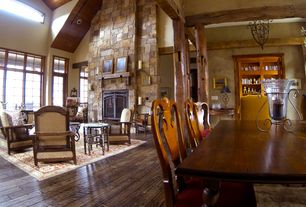 Traditional Living Room with Fireplace, stone fireplace, can lights, Casement, Hardwood floors, picture window, High ceiling