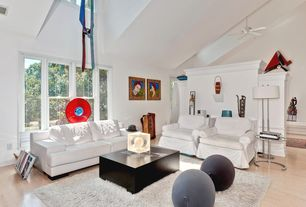 Eclectic Living Room with Ceiling fan, Chair rail, Hardwood floors
