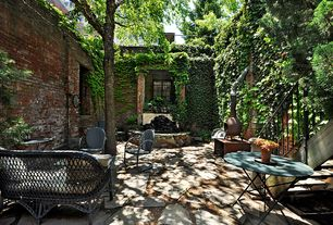 Traditional Patio with Pangaea round iron folding patio dining table, Crosley griffith dining arm chair, Fence