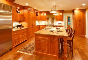Craftsman Kitchen with Simple granite counters, Cabinet finish, Limestone, Wall Hood, can lights, Flat panel cabinets
